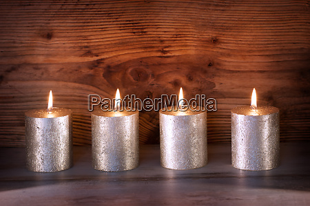 candles in front of dark wood