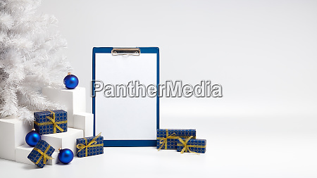 gift boxes blank clipboard and christmas