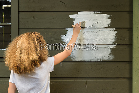 girl painting house
