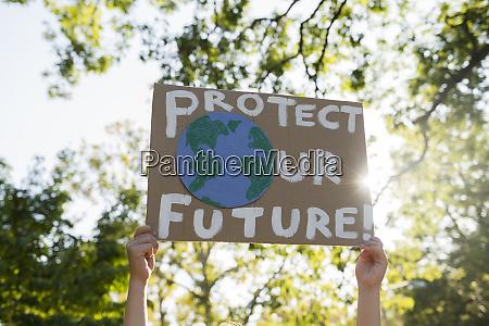 climate change activist holding sign