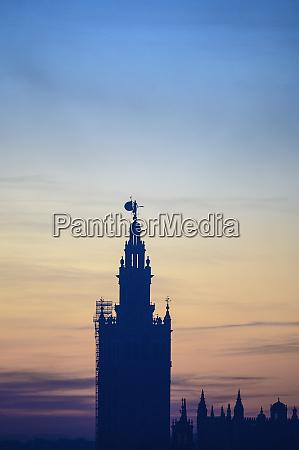 silhouette of giralda at sunrise in