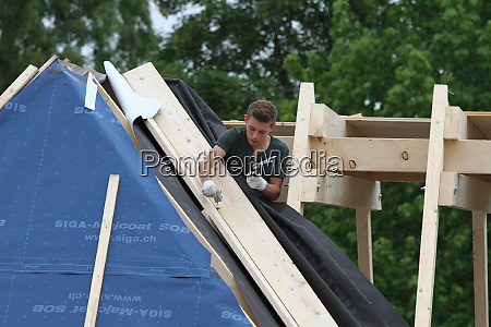 young craftsman works on the