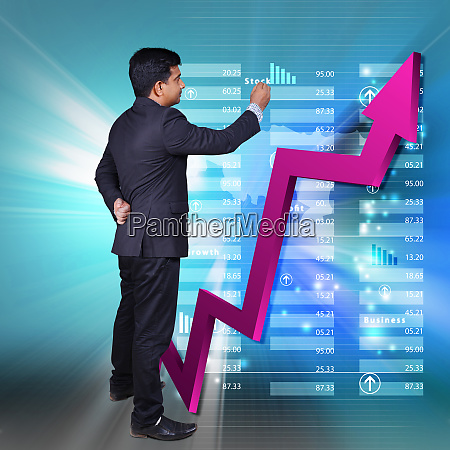 business man showing growth graph