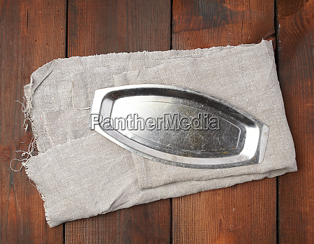 iron empty plate on a gray