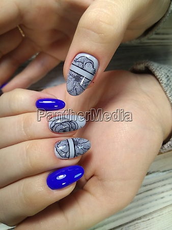 beauty delicate hands with manicure holding