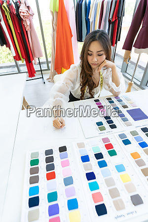 fashion designer owner sketching