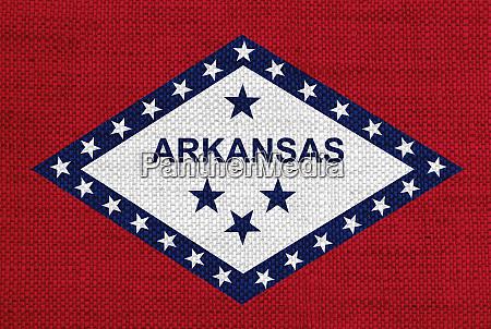 flag of arkansas on old linen