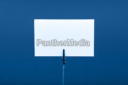 blank white paper sign over blue