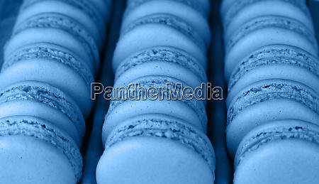 fresh baked blue macaroon cookies close