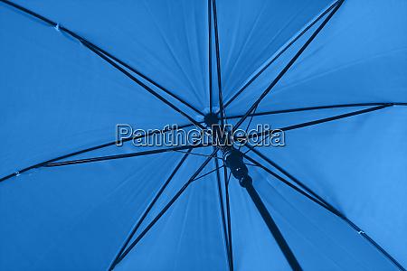 close up blue umbrella low angle