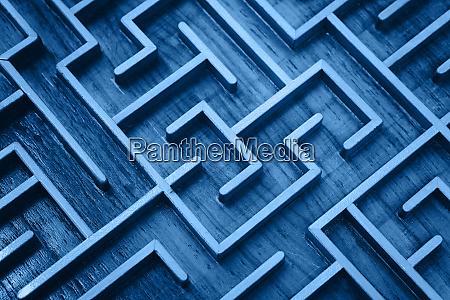 blue wooden labyrinth maze puzzle close