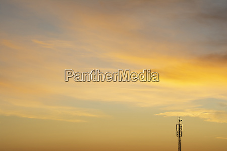 communication antenna tower at dawn time