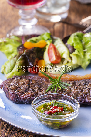 grilled steak a plate with salad