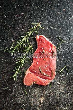 raw veal schnitzel raw meat and