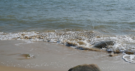 water wave on sandy beach