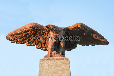 a stone eagle on the base