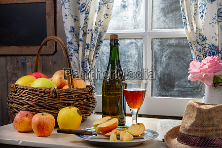 bottle and glass of cider with
