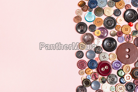 various buttons on pink background with