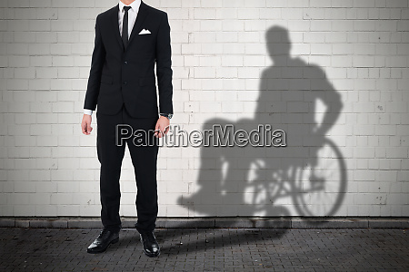 businessman standing with shadow of a