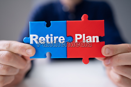 man connecting retirement plan piece into