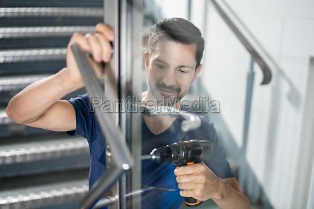 handyman fitting a new door