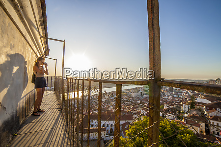 tourist woman taking pictures from coimbra