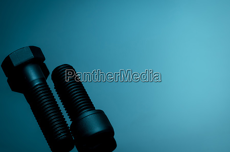 metal bolts on blue background hardware