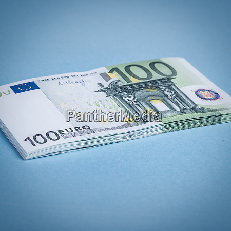 euro cash on a blue and