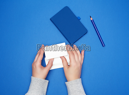 two female hands holding a stack