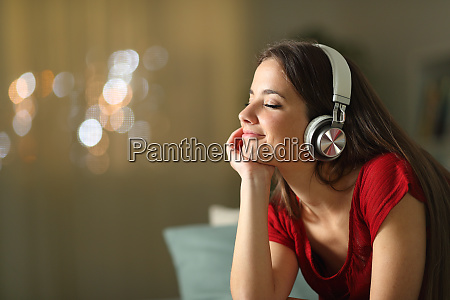 relaxed woman listening to music at