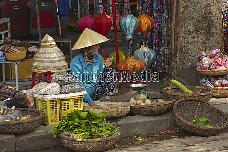 woman with stall at central market