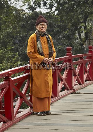 monk on the huc bridge hoan