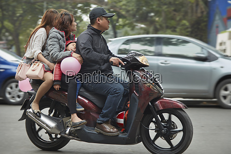 four people on a scooter old