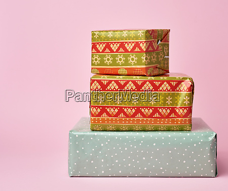 stack of colored paper wrapped gift