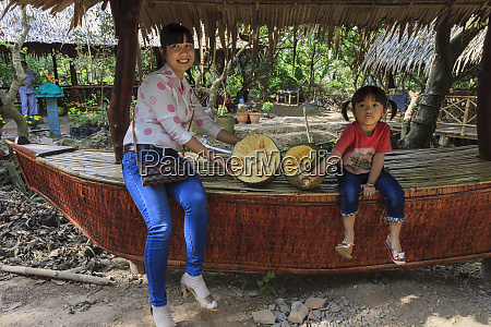 mother and daughter showing durian fruit