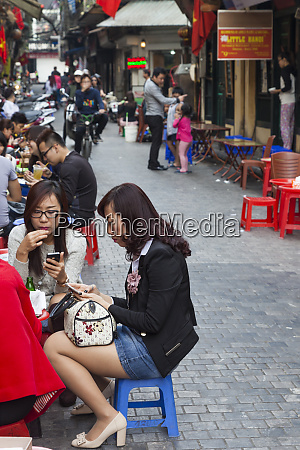 vietnam hanoi street cafe crowds