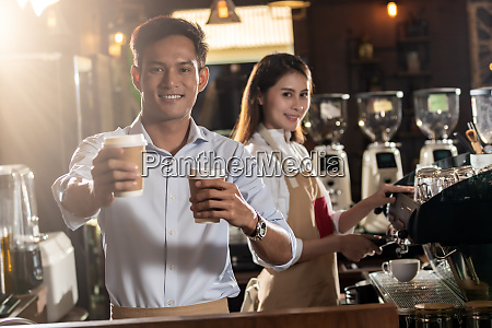 barista serving coffee cup