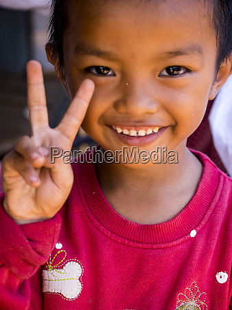 cambodia siem reap young child waving