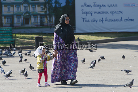 woman with child in panfilov park