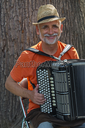 man playing accordion in panfilov park