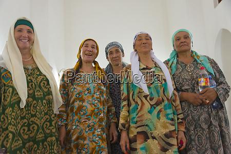 kazakh women inside the mausoleum of