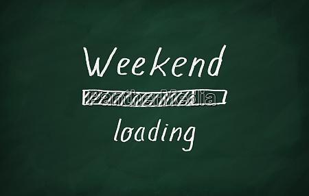 loading weekend writed on a blackboard