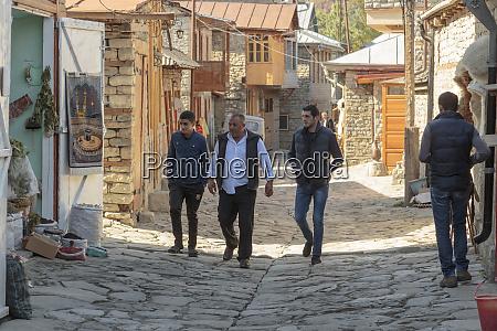 azerbaijan lahic men walking down one