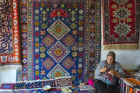woman in a handicraft shop lahij