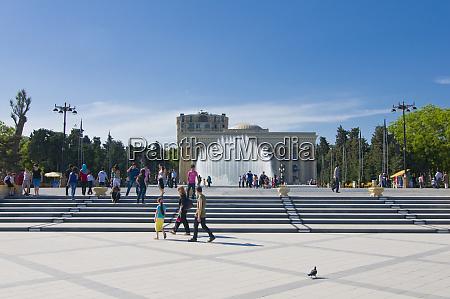 pedestrians at baku seafront azerbaijan