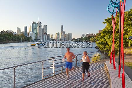 jogger and brisbane skyline queensland australia