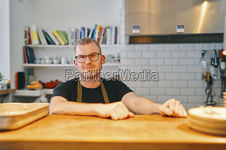 waiter waiting at service counter in