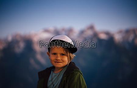 boy enjoying view on peak bludenz