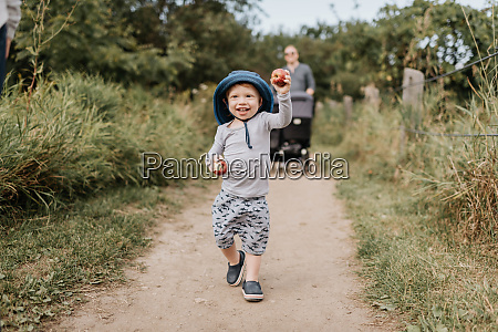 toddler and parent taking walk in