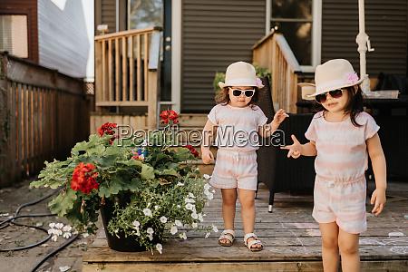 sisters coming down stairway in backyard